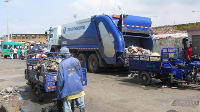 Zoomlion and AMA workers collecting filth at the Tema Station.