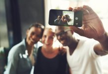 F949JP Multi ethnic friends taking a selfie with a phone (Picture: Alamy)