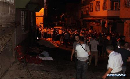 People gather at a blast site in Sahinbey District of Gaziantep province, Turkey, Aug. 20, 2016. A blast occurred near a wedding hall here at 22:40 local time (1940 GMT) on Saturday, leaving at least eight people killed and over 60 injured, security sources told local media. (Xinhua/Mert Macit)