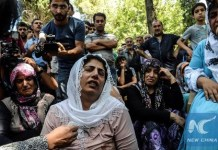 Women cry during a funeral for a victim of last night's attack on a wedding party that left 50 dead in Gaziantep in southeasternTurkey near the Syrian border on August 21, 2016. At least 50 people were killed when a suspected suicide bomber linked to Islamic State jihadists attacked a wedding thronged with guests, officials said on August 21. (Xinhua/AFP Photo)