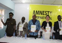 Amnesty International officials launching the toolkits