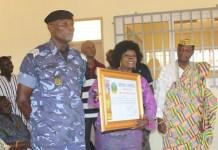 Mr Ashigbi receiving the citation.