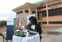 Executive Director of Enterprise Life, Mrs. Jacqueline Benyi addressing dignitaries in front of the Social Centre