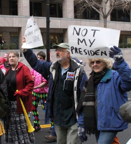 People take part in a demonstration against Donald Trump who was sworn in on Friday as the 45th President of United States in Washington D.C., the United States on Jan. 20, 2017. Ninety-five people were arrested as American protesters clashed with riot police in Washington Friday afternoon after Donald Trump was sworn in as the new U.S. President. (Xinhua/Zheng Qihang)