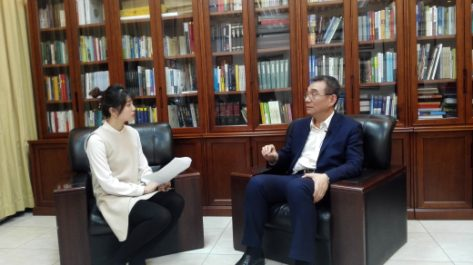 Justin Yifu Lin gives interview to the People's Daily. (Photo by Quan Yajun)