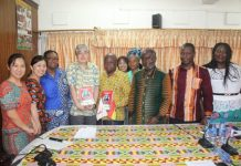 Health Minister and Chief Representative of JICA flanked by officials of JICA and the Ghana Health Service