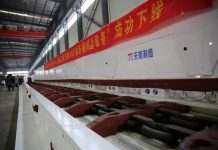 The world's first 8.8-meter smart scraper conveyor for a working face with large mining height is completed, Jan. 28, 2018. Since the major equipment was developed independently by China in 2011, it has replaced the imported equipment from Europe and the US. It has been granted 37 patents and won many prizes of mining industry. (Photo from CFP)