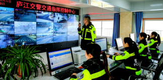Traffic police of Lujiang county, Anhui province are monitoring and managing traffic by applying new technologies, February 11, 2018. (Photo by Zuo Xuechang from People's Daily Online)