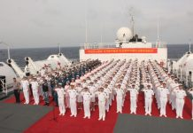 A flag-raising and oath-taking ceremony is held on Chinese naval hospital ship Peace Ark on August 1, 2017. (Photo from People's Daily Online)