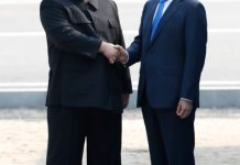 South Korean President Moon Jae-in (R) shakes hands with top leader of the Democratic People's Republic of Korea (DPRK) Kim Jong Un in the border village of Panmunjom on April 27, 2018. Moon Jae-in arrived Friday morning in the border village of Panmunjom for his first summit with Kim Jong Un. (Xinhua/Inter-Korean Summit Press Corps)