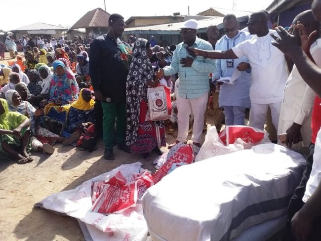 The Director of VIP Jeoun Transport Limited, Mr Yaw Amponsah Marfo, presenting the items to one of the widows in Wa on Friday.