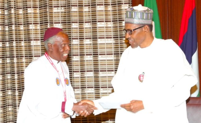PRESIDENT BUHARI RECEIVES CHERUBIM AND SERAPHIM DELEGATION 2B President Muhammadu Buhari receives a document from the Leader of the Delegation, His Most Eminence Prophet Dr Solomon Alao during a courtesy visit at the State House Abuja. PHOTO; SUNDAY AGHAEZE. JAN 4 2019.