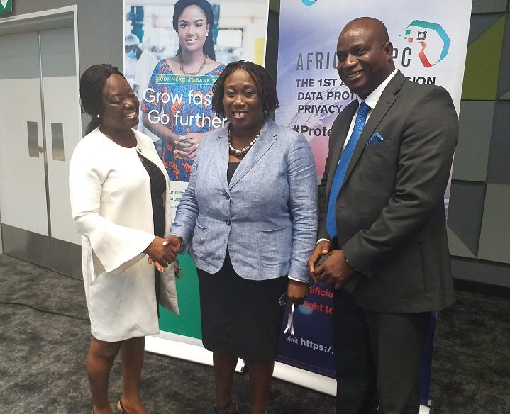 Data Protection Commissioner, Patricia Edusei-Poku (middle), flanked by Rita Tsegah and Roland Gyan from Ecobank