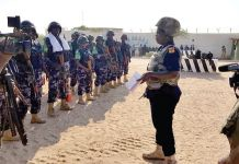Inspector Peace Abra Nyampo (right), Joint Operations Co-ordinator of the AMISOM, addressing a parade of police personnel before dispatching them to their various duty points