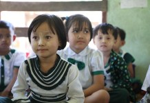 Students of the Nyaung Thone Bin village school attend class in a renovated classroom. Photo by Zhao Yipu from People's Daily