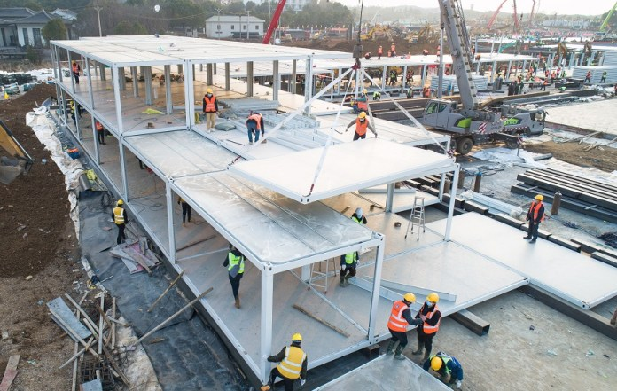 Aerial photo taken on Jan. 28, 2020 shows laborers working at the construction site of Huoshenshan Hospital in Wuhan, central China's Hubei Province. The construction of Huoshenshan Hospital, a makeshift hospital for treating patients infected with the novel coronavirus, is underway in Wuhan. (Xinhua/Xiao Yijiu)