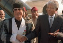 Libya Leader Col. MUammar Gaddafi and South African counterpart Nelson Mandela during the early 1990s.