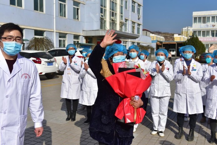 A patient of novel coronavirus is discharged from a hospital in Tianshui, northwest China's Gansu province, Feb. 19, 2020. Photo by Zhou Wentao, People's Daily Online