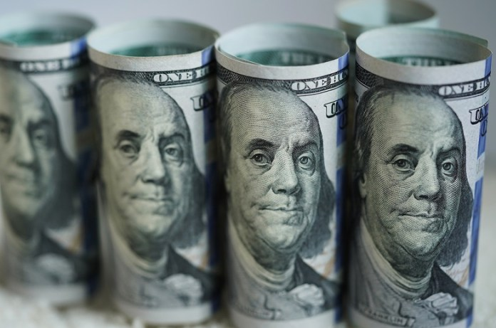 Photo taken on March 19, 2020 shows U.S. dollar banknotes in Washington D.C., the United States. The Trump administration's plan to send Americans relief money as part of a massive stimulus package in response to COVID-19 could be 1,000 U.S. dollars per person, and 500 dollars per child, Treasury Secretary Steven Mnuchin said Thursday. (Xinhua/Liu Jie)