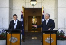 Australian Prime Minister Scott Morrison (right) and Australia's Chief Medical Officer Brendan Murphy speak to the media about the COVID-19 Coronavirus during a press conference at Parliament House in Canberra, Australia, 18 March 2020. EPA/LUKAS COCH AUSTRALIA AND NEW ZEALAND OUT