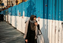 A woman covers her mouth with scarf on a street in Tehran, Iran, on Dec. 4, 2019. At least 56 people have died from flu in Iran over the past two months, Iranian Deputy Health Minister Alireza Reisi was quoted as saying by semi-official Mehr news agency on Monday. (Photo by Ahmad Halabisaz/Xinhua)