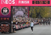 """Kenya's Eliud Kipchoge crosses the line during the match of """"1:59 challenge"""" in Vienna, Austria, on Oct. 12, 2019. Eliud Kipchoge completed the """"1:59 challenge"""" successfully in 1h 59m 40.2s. (Xinhua/Guo Chen)"""