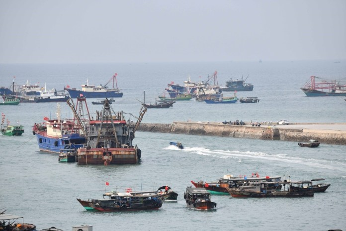 Photo taken on March 24, 2020 shows fishing vessels near a port in Yinhai district of Beihai, south China's Guangxi Zhuang Autonomous Region. Ports in the city have resumed work to improve fish production amid epidemic prevention and control. Photo by Li Junguang/People's Daily Online
