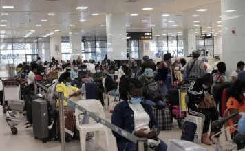 Ghanaian evacuees from Lebanon going through immigration checks at the Kotoka international Airport in Accra