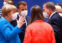 German Chancellor Angela Merkel gestures as she speaks with France's President Emmanuel Macron, Finland's Prime Minister Sanna Marin and Sweden's Prime Minister Stefan Lofven during the first face-to-face EU summit since the coronavirus disease (COVID-19) outbreak, in Brussels, Belgium July 18, 2020. REUTERS/Francois Lenoir/Pool