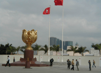 China's national flag and the flag of the Hong Kong Special Administrative Region on the Golden Bauhinia Square in Hong Kong Photo by Qian Weixin/People's Daily Online