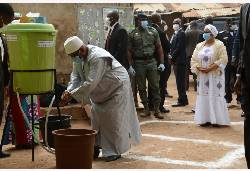 Malian President Ibrahim Boubacar Keita washes his hands after arriving at a polling station in Bamako, Mali on April 19, 2020. The second round of legislative elections kicked off this Sunday at 8 a.m. GMT for Malian voters to choose the remaining 125 of the 147 deputies for Mali's National Assembly. (Photo by Habib Kouyate/Xinhua)