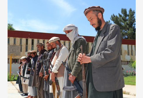 PUL-E-KHUMRI, May 20, 2020 (Xinhua) -- Taliban militants attend a surrender ceremony in Pul-e-Khumri, capital of Baghlan province, Afghanistan, May 20, 2020. Fifteen Taliban militants surrendered and handed over their weapons in Afghanistan's northern province of Baghlan on Wednesday, as the government has been trying to reconcile the insurgents after more than two decades of insurgency. (Photo by Sahel/Xinhua)
