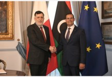 Maltese Prime Minister Robert Abela (R) shakes hands with Libyan Prime Minister Fayez Serraj during their meeting in Valletta, Malta, on July 6, 2020. Malta and Libya should continue to work better together to prevent loss of lives at sea, Maltese Prime Minister Robert Abela told his Libyan counterpart Fayez Serraj here on Monday. (Photo by Jonathan Borg/Xinhua)