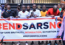 Nigerian Youth Carry Endsars Banner