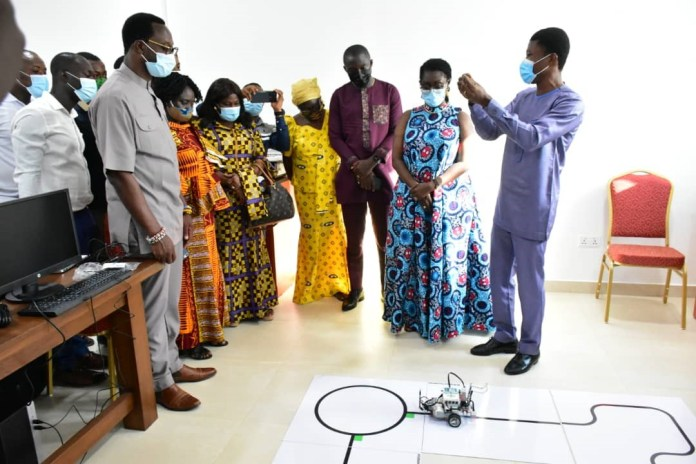 A Facilitator From The Ghana Robotics Academy Foundation Explaining To Hon Minister Ceo Of Mtn And Other Dignitaries How They Use Robotics To Teach And Develop Solutions