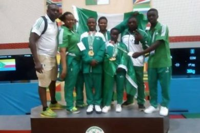 Team-Nigeria-weightlifter-receiving-medals