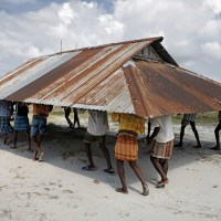 Climatic paradox of Bangladesh: climate change versus adaptation