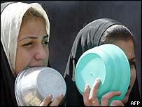 Women queue for food