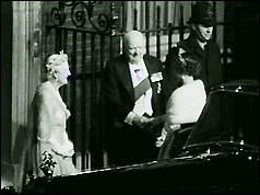 Winston Churchil greets the Queen