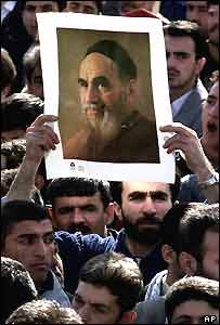 An Iranian demonstrator holds a picture of Ayatollah Khomeini during a celebration to commemorate the 23rd anniversary of Iran's 1979 Islamic Revolution