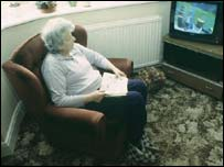 Elderly lady watching tv