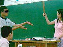 A pupil being caned by his teacher in Taiwan