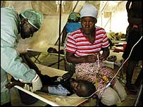 Doctor treating cholera victim (Pic: Paco Arevalo, MSF)