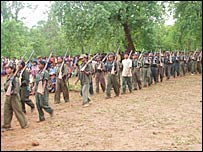 Maoist fighters march in a show of strength