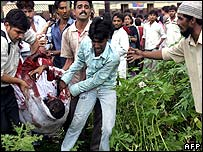 Injured passenger being carried from train