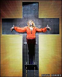 Madonna on a wire cross during a performance on the Confessions tour