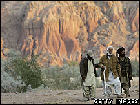 Nawab Akbar Bugti (centre) helped by guerrillas in at a remote camp outside of Dera Bugti in January 2006