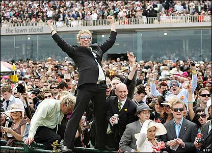 Fans celebrate in the huge crowd as Delta Blues wins the Melbourne Cup