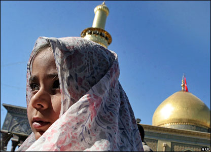 A Shia girl attends Friday prayers at a mosque in Karbala, central Iraq
