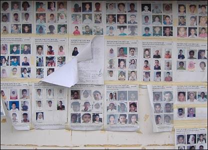 The wall of missing, by 13-year-old  Yusindar, Al Aziziyah boarding school/orphanage, Banda Aceh